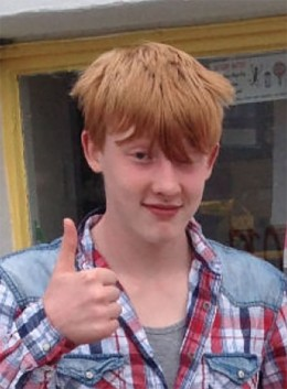 red head with thumbs up